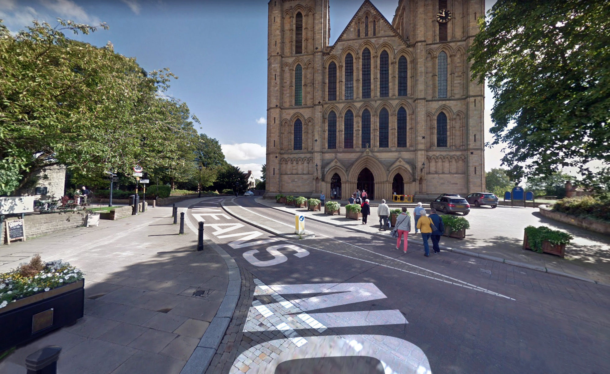 Photograph of Ripon Cathedral with large white floor graphics