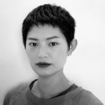 black and white image of a woman with dark short hair.