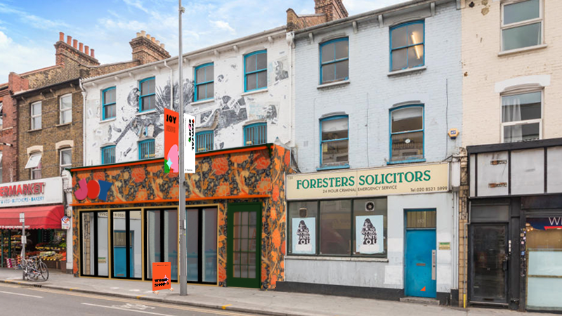 image of Walthamstow hughstreet with a shop front decorated in William Morris wallpaper.
